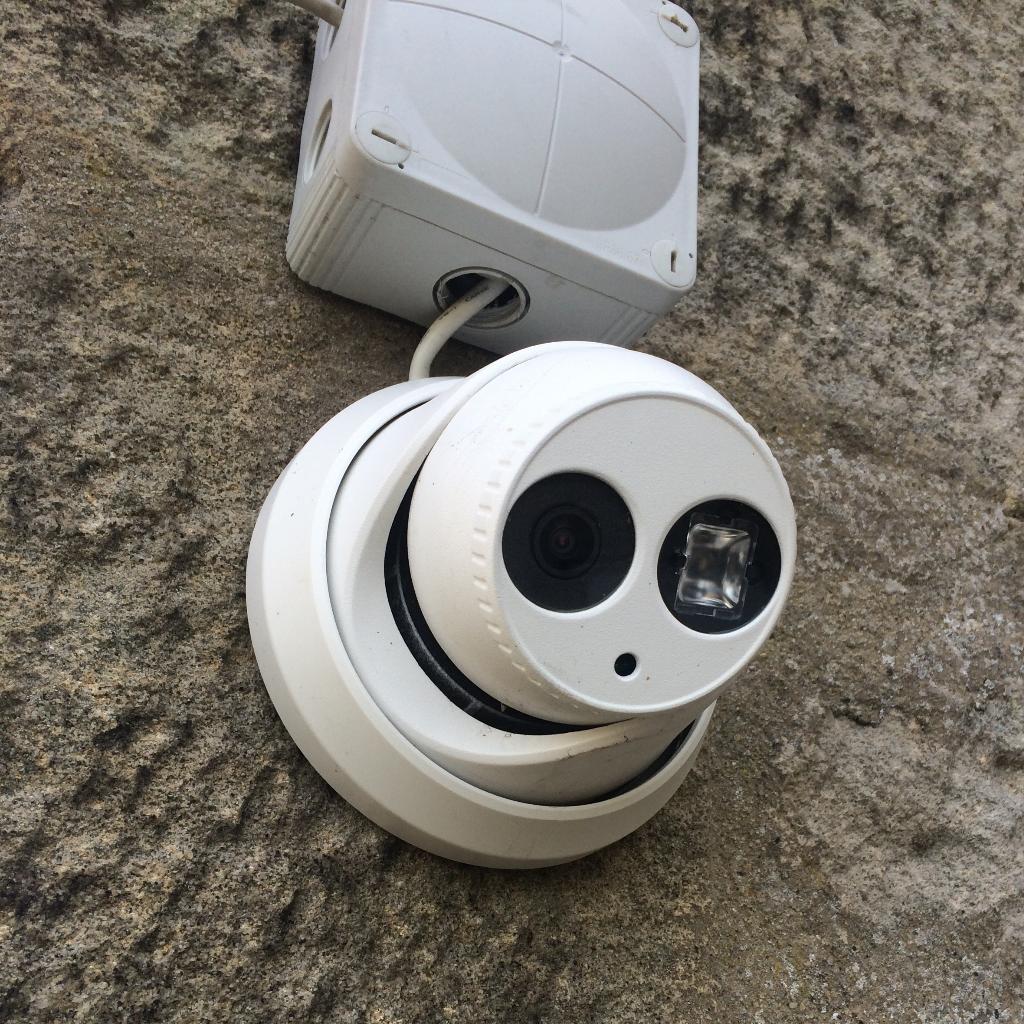 white cctv camera installed